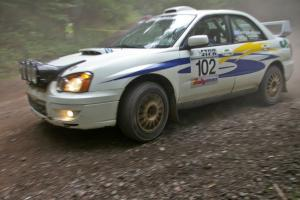 George Georgakopoulos / Faruq Mays Subaru WRX at a hairpin on SS6.