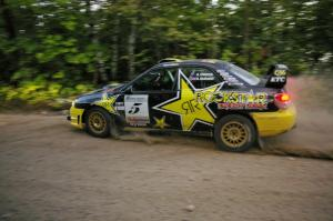 Andy Pinker / Robbie Durant lost alot of time on SS15 changing a tire on their Subaru WRX STi.