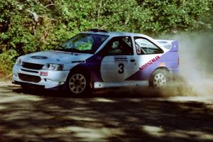 Carl Merrill / Lance Smith Ford Escort Cosworth RS at the spectator point on SS10 (Kabekona).