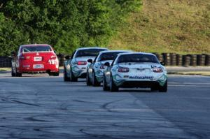 A Honda Civic Si and three Mazda MX-5s at turn 7