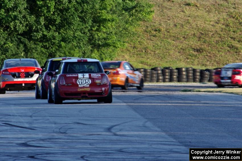 Kyle Gimple / Randall Smalley and Chris Puskar / Dicky Riegel Mini Cooper Ss at the end of a group of ST cars at turn 7