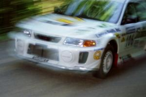 Gabriel Marin-Ortiz / Mark Williams Mitsubishi Lancer Evo V at speed on the practice stage.