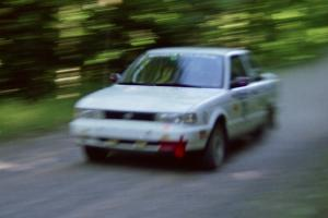 Ted Mendham / Lise Mendham Nissan Sentra SE-R at speed on the practice stage.