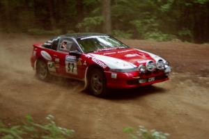 Arthur Odero-Jowi / Jim Hurley Mitsubishi Eclipse powers out of a hairpin on SS5, Thompson Point I.