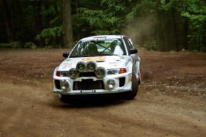 Gabriel Marin-Ortiz / Mark Williams Mitsubishi Lancer Evo V at a hairpin on SS5, Thompson Point I.
