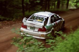 Gabriel Marin-Ortiz / Mark Williams Mitsubishi Lancer Evo V powers out of a hairpin on SS5, Thompson Point I.
