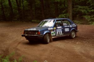 Mark Utecht / Diane Sargent Dodge Omni GLH-Turbo at a hairpin on SS5, Thompson Point I.