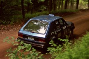 Mark Utecht / Diane Sargent Dodge Omni GLH-Turbo powers out of a hairpin on SS5, Thompson Point I.