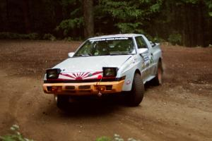 Mark Bowers / Duffy Bowers Mitsubishi Starion powers out of a hairpin on SS5, Thompson Point I.