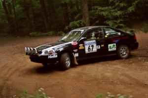 Jay Kowalik / Scott Embree Honda Civic CVT at a hairpin on SS5, Thompson Point I.
