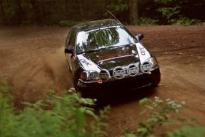 Jay Kowalik / Scott Embree Honda Civic CVT powers out of a hairpin on SS5, Thompson Point I.