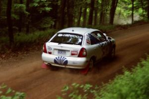 Peter Malaszuk / Darek Szerejko Daewoo Nubira powers out of a hairpin on SS5, Thompson Point I.