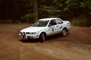 Ted Mendham / Lise Mendham Nissan Sentra SE-R slides into a hairpin on SS5, Thompson Point I.