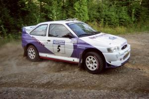 Stig Blomqvist / Lance Smith Ford Escort Cosworth RS at a hairpin on SS3, Grafton I.