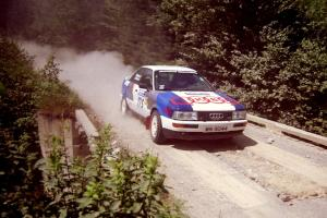 Alex Erisoty / Ben Greisler Audi 90 Quattro at speed over a bridge on SS5, Magalloway North.