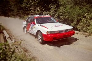 Arthur Wojcik / Chuck Cox Mitsubishi Galant VR-4 at speed over a bridge on SS5, Magalloway North.
