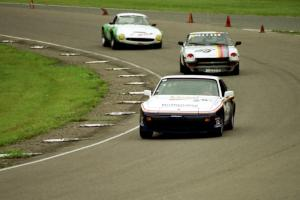 Joe Rothman's ITS Porsche 944, Bill Tapper's ITS Datsun 240Z and Mark Knepper's SSZ Stradale through turn 9