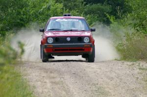 Daryn Chernick / Joe Czubaty come flying over a crest on the practice stage in their VW GTI.