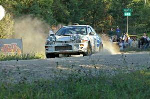 Henry Krolikowski / Cindy Krolikowski blast away from the spectator point on SS13 in their Subaru Impreza.