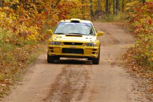 Kyle Sarasin / Mikael Johansson at speed down a straight in their Subaru Impreza near the finish of SS10, Gratiot Lake 1.