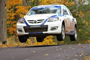 Eric Burmeister / Dave Shindle catch nice air at the midpoint jump on Brockway 2, SS14, in their Mazda Speed 3.
