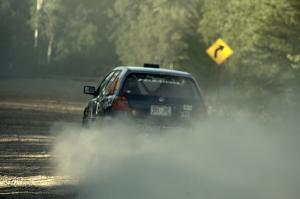 Paul Koll / Heath Nunnemacher fly down the couty road on SS12 in their VW Golf.