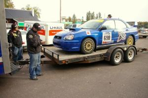Micah Wiitala unloads the Kenny Bartram / Dennis Hotson Subaru WRX STi as Russ Johnson looks on.