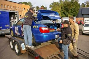 The Sisu Racing crew unloads the Kenny Bartram / Dennis Hotson Subaru WRX STi before it gets teched.