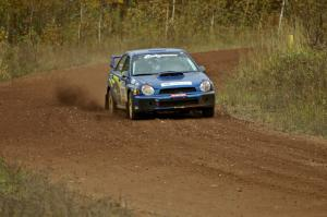 Janusz Topor / Michal Kaminski through a fast sweeper on the practice stage in their Subaru WRX STi.