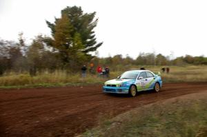 Pete Hascher / Scott Rhoades come into a tight corner on the practice stage in their Subaru WRX.
