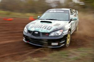 Mark Fox / Jake Blattner drift through a tight corner on the practice stage in their Subaru WRX STi.
