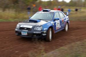 Carl Siegler / David Goodman drift through a tight corner on the practice stage in their Subaru WRX STi.