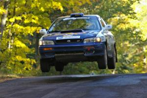 Mason Moyle / Scott Putnam catch air at the midpoint jump on Brockway Mtn. 2, SS16, in their Subaru Impreza.