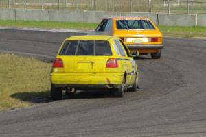 Tom Daly's ITC VW Scirocco leads Brent Carlson's ITJ VW Golf through corner 4