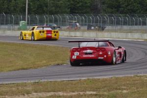 Amy Ruman's Chevy Corvette chases Tony Ave's Chevy Corvette through turn 4.
