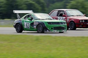 Miaro Racing Mazda Miata passes the Probs Racing BMW 325