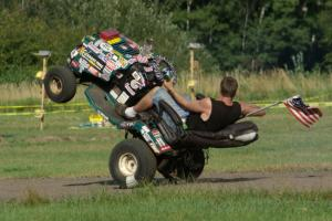 An animal in the infield of BIR rides a wheelie on his riding lawnmower.