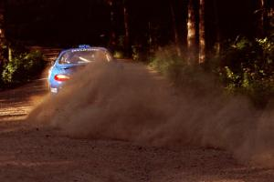 Noel Lawler / Charles Bradley Hyundai Tiburon powers out of a 90-right on SS1, Akeley Cutoff.