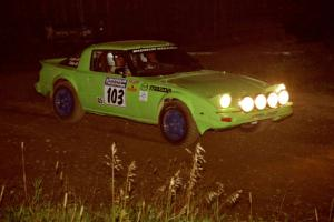 Jim Dale / Bob Logue Mazda RX-7 at speed through the crossroads on SS6, East Steamboat.