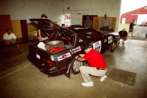 Jens Larsen / Bob Barrall Mazda RX-7 head through tech inspection.