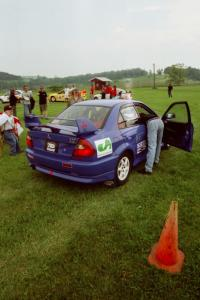 Peter Cunningham / Jim Gill Mitsubishi Lancer Evo VI in line for tech inspection.