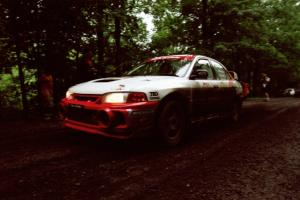 Garen Shrader / Doc Schrader Mitsubishi Lancer Evo IV launches from the start of the practice stage.