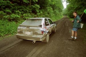 Marty Allen / Peter Watt Mazda 323GTX launches from the start of the practice stage.