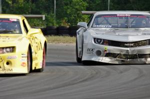 Bob Stretch's and Adam Andretti's Chevy Camaros battle late in the race.