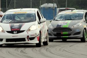 Johan Schwartz's Honda Fit and Nate Stacy's Ford Fiesta