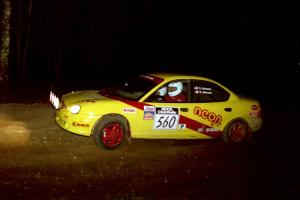 The Dave Johnson / Shannon Johnson Dodge Neon ACR heads uphill at the crossroads hairpin.