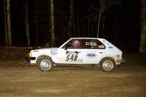 John Zoerner / John Shepski head uphill at the crossroads hairpin in their Dodge Omni GLH Turbo.