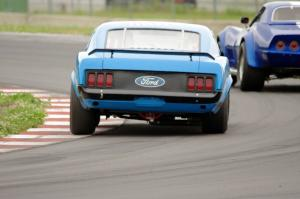 Brian Kennedy's Ford Mustang Boss 302 chases Kent Burg's Chevy Corvette