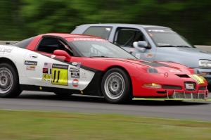 Darrell Peterson's SPO Chevy Corvette passes Glen Wilson's ITS VW GTI