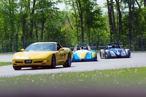 Jose Borrero's and Nate Smith's P2 Radical SR3s on the front row behind the pace car.